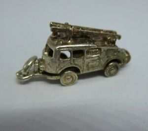Vintage silver fire engine charm opens