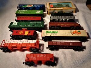 large group of HO  freight cars  readt for your layout