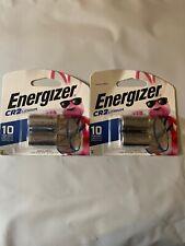 "(4) Energizer ""CR2 Lithium"" batteries. Expiration Date: 2028"