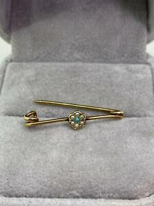 An Antique 14K Yellow Gold, Seed Pearl, Turquoise Stick Pin.