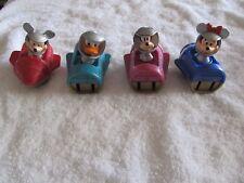 TOMMOROWLAND BY Disney..Set of 4 rockets, Minnie, Mickey, Donald, Goofy..1999!