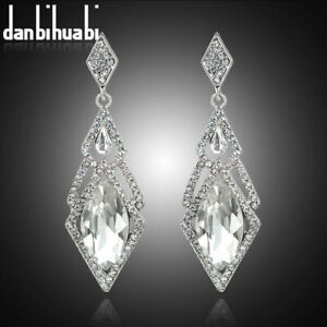 WHITE GOLD FILLED CRYSTAL SAPPHIRE WHITE TOPAZ AND ZIRCON STUD EARRINGS