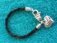 Braided bi-color horse hair bracelet w/heart charm.  Custom or stock hair.
