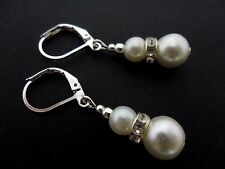 A PAIR OF SHORT DANGLY IVORY GLASS PEARL  SILVER PLATED LEVERBACK HOOK EARRINGS.