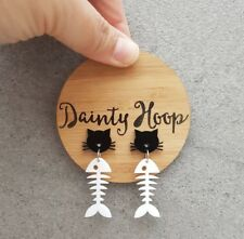 Cheeky black cat with white fish bone acrylic dangle statement stud earrings