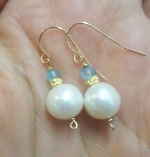 Pair of 14k solid gold freshwater pearl and 2ct blue topaz earrings
