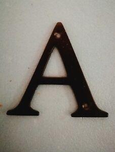 Black metal door letter A