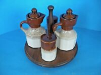 VINTAGE WOODEN LAZY SUSAN WITH SALT & PEPPER SHAKERS AND OIL AND VINEGAR MUGS