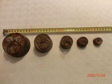 n°1)  Série de poids ronds anciens en fonte pour balance