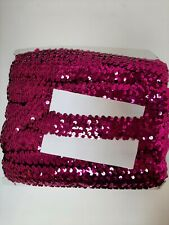 Cerise sequin elasticated trim. Meterage unknown.