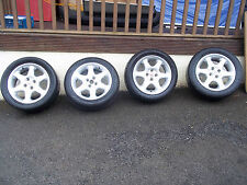 MGF 15 inch wheels with 2 good tyres and 2 need replacing