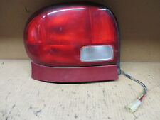 GEO METRO PONTIAC FIREFLY SEDAN 95 96 97 98 99 00 01 TAIL LIGHT DRIVER RED TRIM