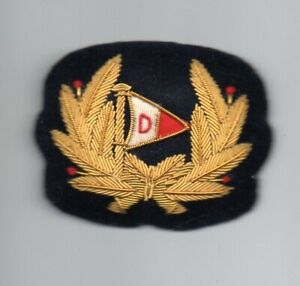 DILMAN  NAVIGATION COMPANY  LONDON  OFFICERS GOLD WIRE CAP BADGE.