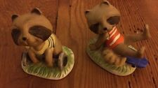 2 Enesco Raccoon Figurines
