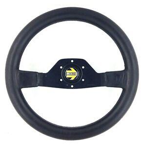 Genuine Momo 350mm, Two spoke black leather steering wheel. Dated 1980. RARE! 7B
