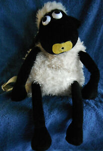 *1903a*  Backpack in the shape of black / cream Sheep - 34cm - plush
