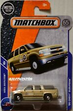 MATCHBOX 2018 MBX SERVICE '00 CHEVY SUBURBAN POLICE CAR GOLD