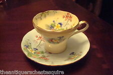 Aynsley  footed cup & saucer decorated with flowers, in yellow & green[4-*59]