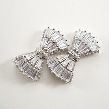 Diamond bow shape sterling silver (925 silver) with white gold plated earrings.
