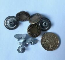 Brass coloured jeans buttons.  Pack of five with back fastening screws.
