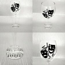 A pair of theatre, music decoupage wine glasses,  comedy and tragedy masks