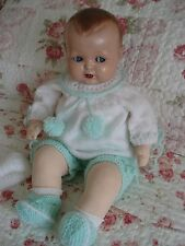COMPOSITION    HEAD BABY DOLL WITH FLIRTY EYES . CLOTH BODY . GERMANY