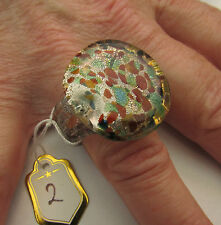 A ROUND LAMPWORK GLASS RING. UK..S. US..9.   (25mm x 25mm)  (2)