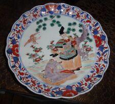 IMARI porcelaine assiette au décor de personnages XIXe