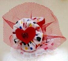 Colourful mini top hat with hearts, clubs, diamonds, and spades.
