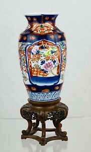 Imari Hand Painted Vase, With Bird and Floral Design on Hand Carved Wood Plinth