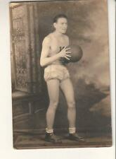 early 1900's posed photo college age basketball player in uniform with ball