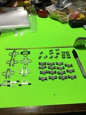 LARGE VINTAGE 60 PIECE GROUPING ASSORTED SLOT PARTS / MOTOR SUPPORT / AXLE / NOS