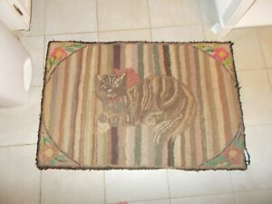 EARLY 1900S HAND HOOKED RUG WITH A GRAY STRIPPED CAT WITH PINK RIBBON FLOWERS