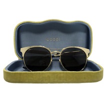GUCCI ROUND SUNGLASSES WITH GOLD FRAME, GG0075S