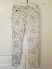 lady's gray and white floral jeans