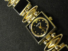 AUTHENTIC Starlite ladies watch 7 3/4 inches, sharp goldtone watch