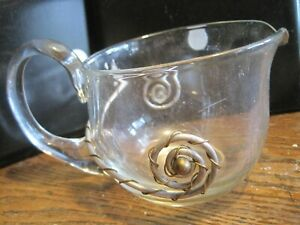 CLEAR GLASS GRAVY HOLDER W/APPLIED GLASS HANDLE&DECORATIVECOPPER&METAL ACCENTS