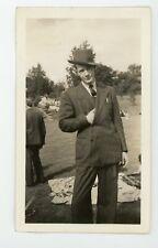 Jaunty man in slanted hat / hand in suit  - vintage snapshot found  photo