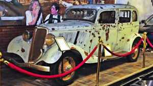Bonnie and Clyde's Death Car on display vintage photo reproduction