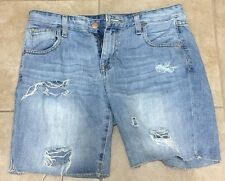 Mossimo light wash distressed and ripped denim shorts size 4/27
