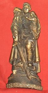 Vintage Soviet Russian brass plaque soldier holding child and sword