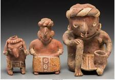 THREE NAYARIT FIGURES C. 200 BC - 200 AD INCLUDING A FIGURE CARRY... Lot 70270