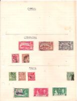 5 old GIBRALTAR + 7 old MALTA stamps on an album page.