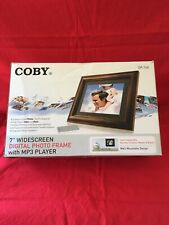 """Coby 7"""" Digital Photo Frame Controlled w/ MP3 Player"""