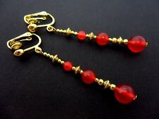 A PAIR RED JADE BEAD GOLD TONE EXTRA LONG DANGLY CLIP ON EARRINGS. NEW.