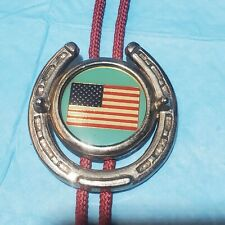 BOLO TIE - AMERICAN FLAG AND HORSE SHOE WITH MAROON ROPE        #38