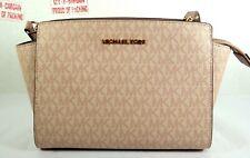 a4e98d0a95a8 Michael Kors Selma Medium PVC Signature Messenger Bag in Fawn Ballet