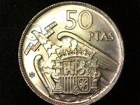 50 pesetas 1957 estrella 60 casi sin circular - variante 2 plumas ala (A1)