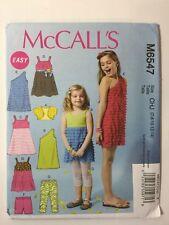 McCall's 6547 Size 7-14 Girls' Shrug Top Dresses Shorts Leggings