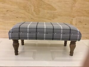 Footstool upholstered in a Mobus Grey stripe fabric